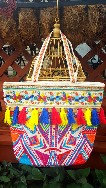 Multi Colored woven bag with beads, tassels, and coins