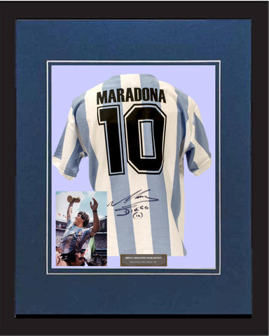"SC - Maradona Signed jersey and photograpgy - World Cup Champion 1986 in 20"" x 28"" frame (50cm x 70cm)"