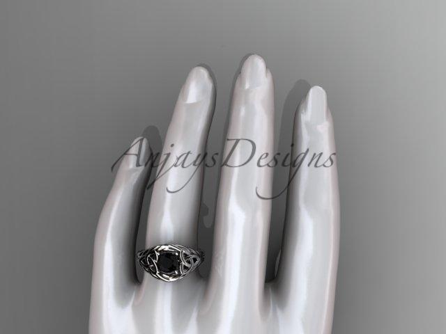 14kt white gold celtic trinity rope wedding ring with a Black Diamond center stone RPCT964