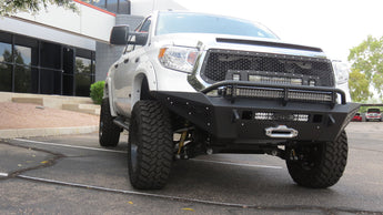 "Toyota Tundra HoneyBadger Front Bumper with Winch Mount and 40"" Light bar and 20"" light bar in skid and 10"" Light bar in side panels with HB Logo in Hammer Black with Satin Black panels"