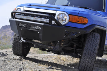 "2007 - 2014 Toyota FJ Cruiser Stealth Fighter front bumper with 20"" LED mounts in center and 30"" LED mounts with top hoop with dually mounts in sides in Hammer Black with Satin Black Panels"