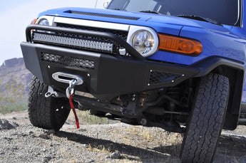 "2007 - 2014 Toyota FJ Cruiser Stealth Fighter front bumper with winch and 20"" LED mounts in center and 30"" LED mounts with top hoop with dually mounts in sides in Hammer Black with Satin Black panels"