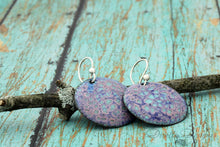 Load image into Gallery viewer, Round Boho Earrings in Blue & Tallow on sterling silver ear wires resting on a branch