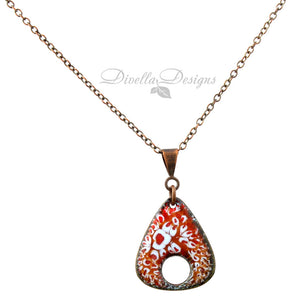 Reddish-orange and light blue rounded triangle necklace on a copper bail and chain