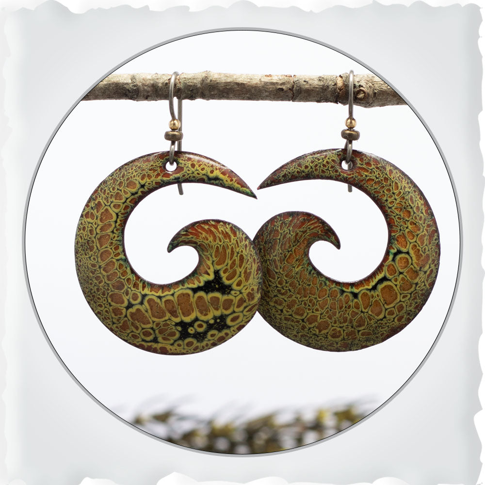 Black, copper and yellow spiral shaped boho earrings by Divella Designs. The ear wires are niobium.