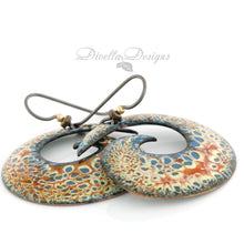 Load image into Gallery viewer, Big spiral boho earrings in blue, orange and cream with niobium ear wires.