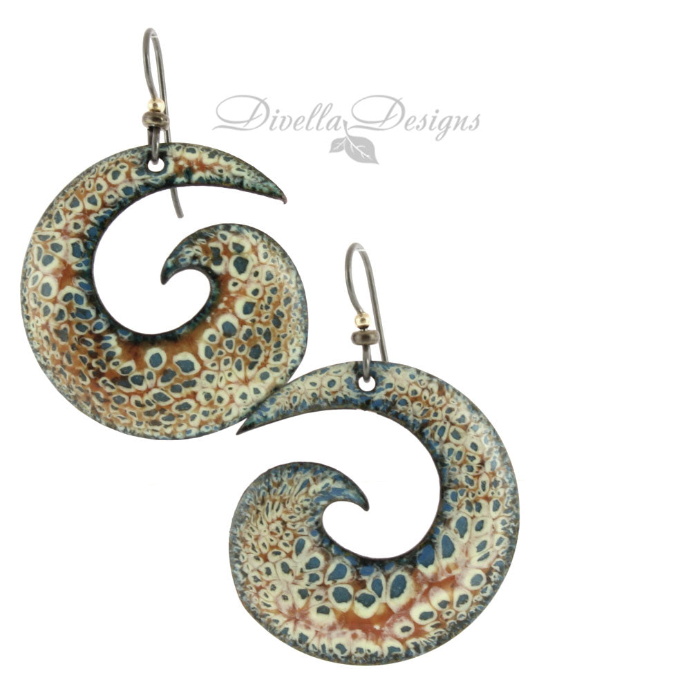 Big spiral boho earrings in blue, orange and cream with niobium ear wires.