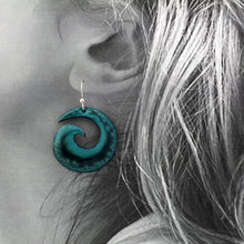 Load image into Gallery viewer, Deep turquoise spiral earrings n a model