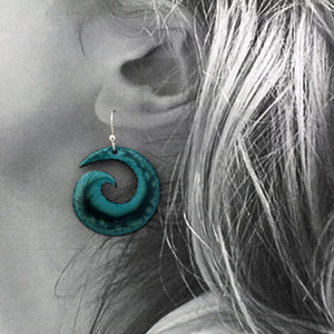 Deep turquoise spiral earrings n a model
