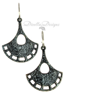 Black and white pendulum shaped boho earrings on white background. The ear wires are made of niobium.