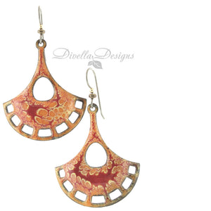Dark and light orange and yellow pendulum shaped boho earrings by Divella Designs. The ear wires are niobium.