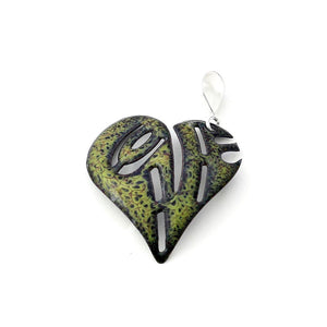 green heart pendant with sterling silver bail