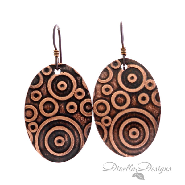 boho copper earrings with circular pattern