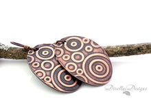 Load image into Gallery viewer, boho copper earrings with circular pattern on branch