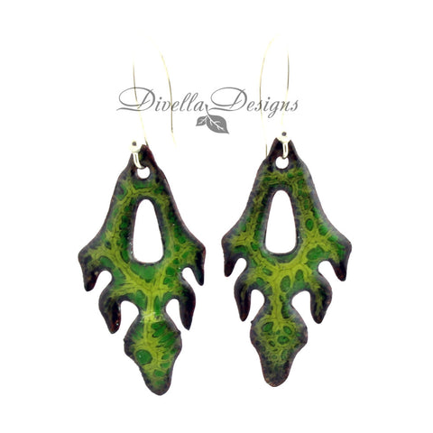 Frond shaped boho earrings in light and dark greens. The ear wires are sterling silver.