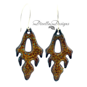Pumpkin and yellow frond shaped enamel earrings on a white background by Divella Designs