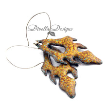 Load image into Gallery viewer, Pumpkin and yellow frond shaped enamel earrings on a white background by Divella Designs