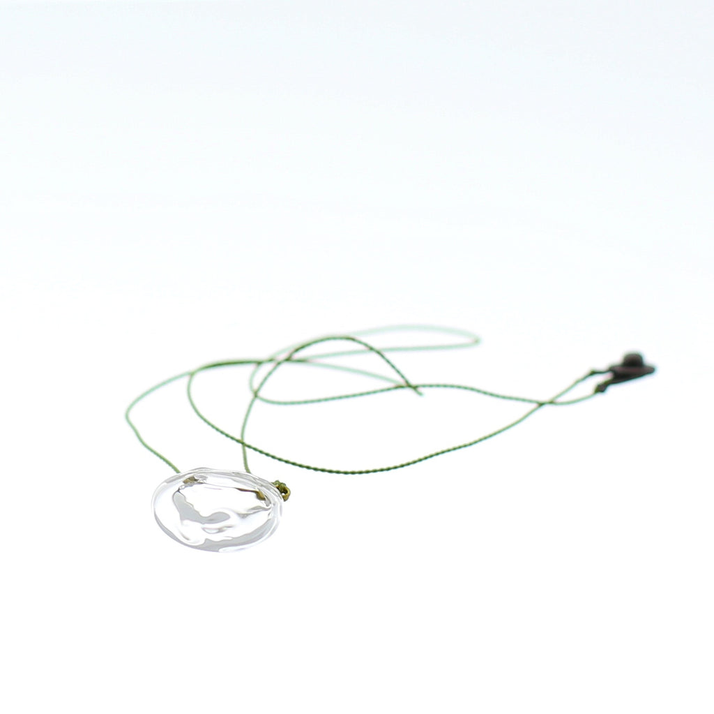 Close up of Air Bubble Pendant - Round Spring Leaf Green Glass Neckless with Silk Thread Made in Japan