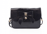 Cute bow adornment to the front Flap over finished with magdot Detachable crossbody strap	 Twin compartments inside Gold tone metal hardware   Handle drop: max. 70cm	  Dimensions: H12.5cm x W17cm x D1cm	  Material: Synthetic