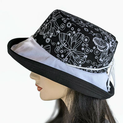 102-d Sunblocker wide brim sun hat with white butterfly outlines on black