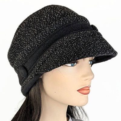 Fashion cap in black textured knit with white specks, ear saver buttons