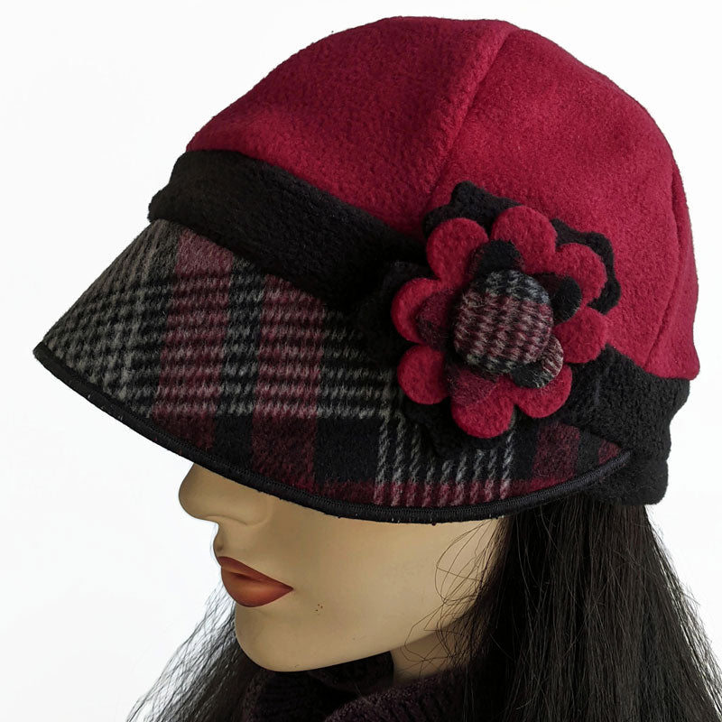Fleece cap in burgundy and black with pin and ear saver buttons