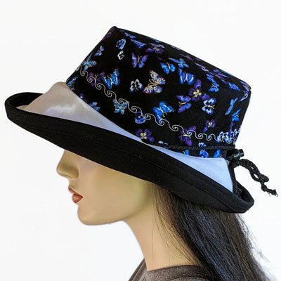 107-b Sunblocker UV summer sun hat featuring butterflies and pansies on black