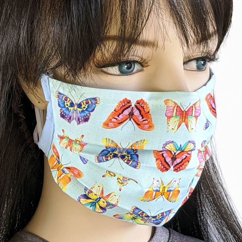 3 layer pleated folding style fabric face mask, featuring butterflies in blues, one size