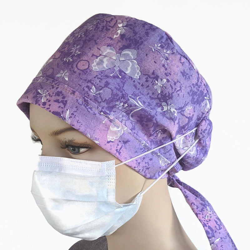 Nurses cotton scrub cap, elastic and tie fit, built in matching elastic buttons, purple butterflies