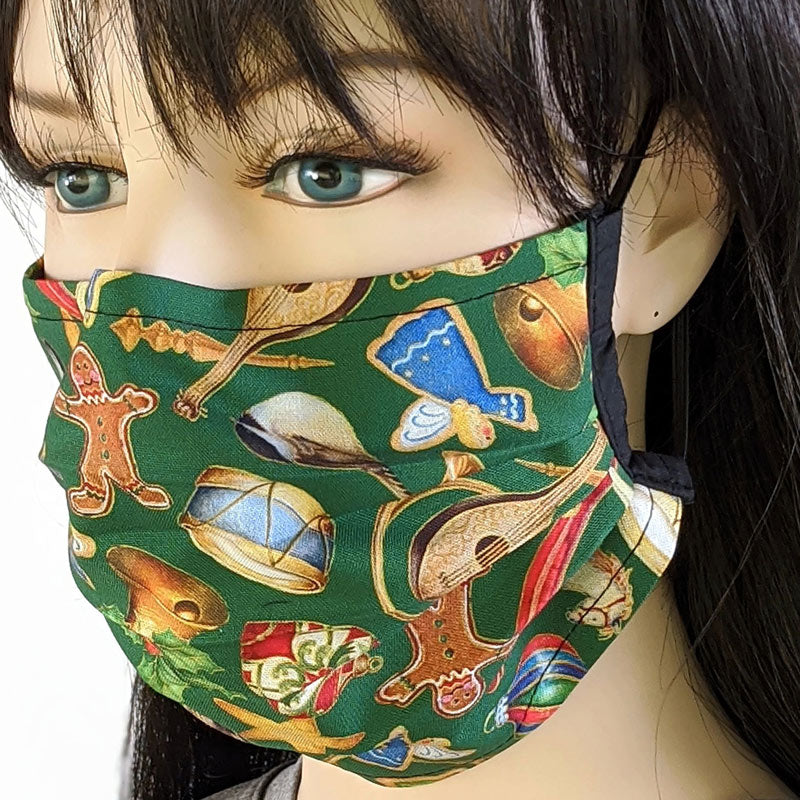 3 layer pleated folding style fabric face mask, symbols of Christmas on green