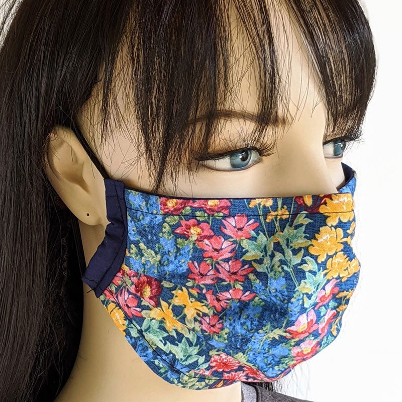 3 layer pleated folding style fabric face mask, featuring country garden flowers on blue, one size