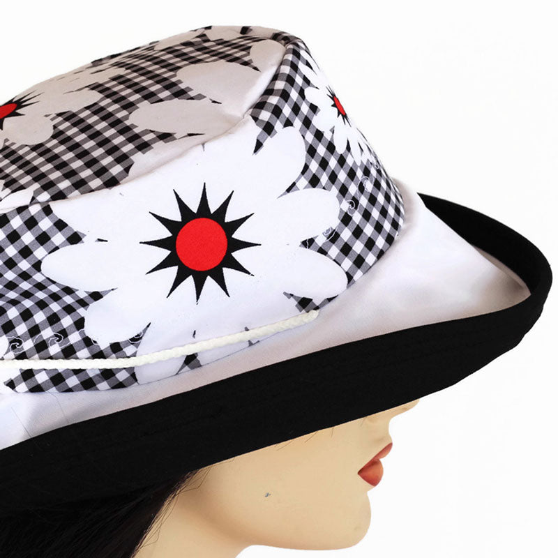121 Sun hat with large wide brim featuring colourful gingham and daisies