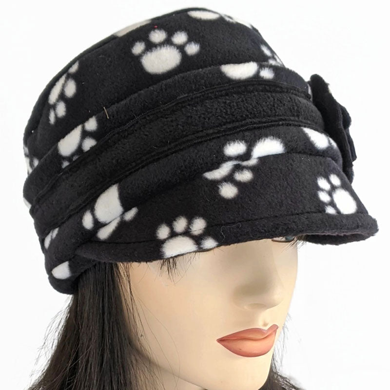 Fleece cap with floral pin featuring fun doggie paw print