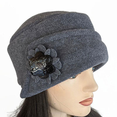 Fleece Fashion Cloche with ear saver buttons and floral pin, assorted colors