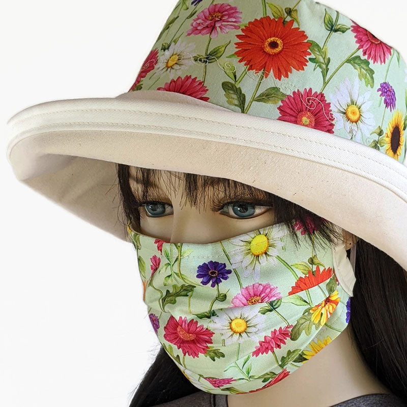3 layer pleated folding style fabric face mask, featuring gerberas and daisies, one size