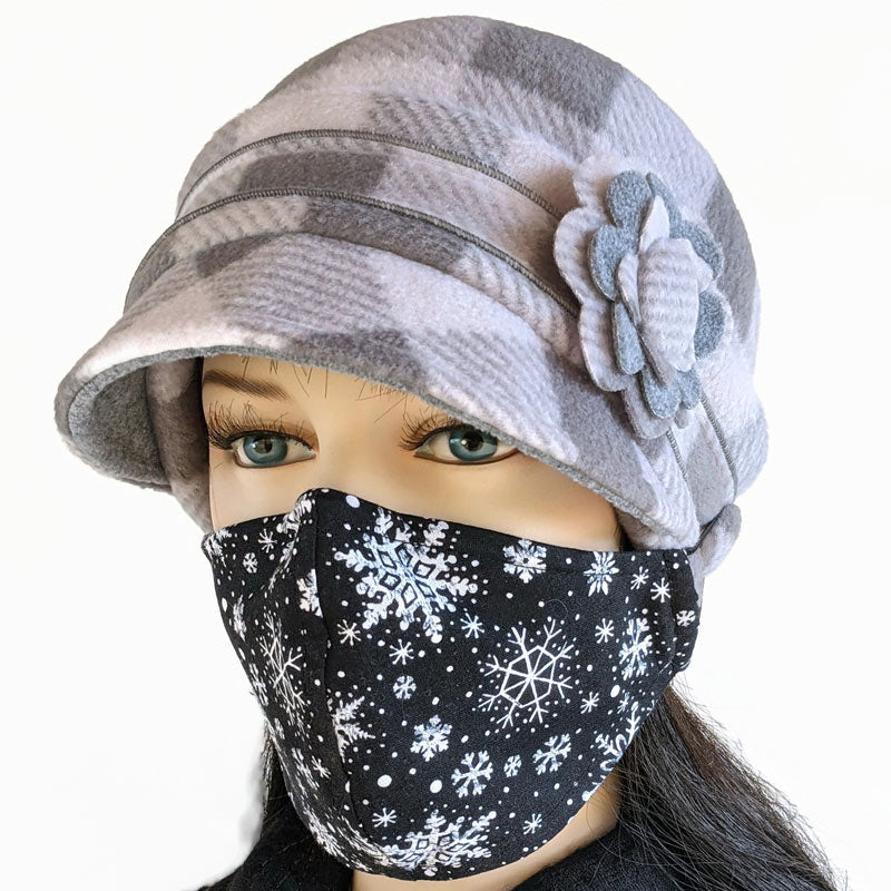 Fleece Cap with floral pin in grey Buffalo check with ear saver buttons