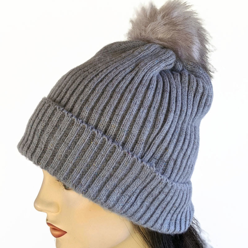 Knit Hat with in light grey with furry lining and pompom