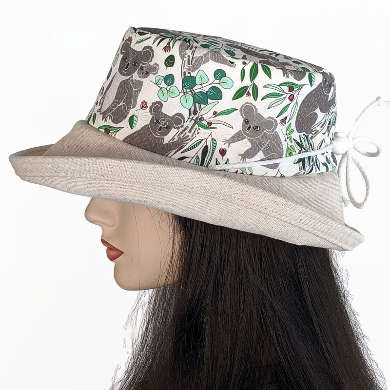 103 UV Sunblocker with wide brim featuring koalas