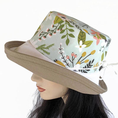118 Sunblocker with wide brim featuring green floral print