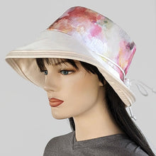 Sunblocker UV summer sun hat with large wide brim with colourful floral watercolour inspired print