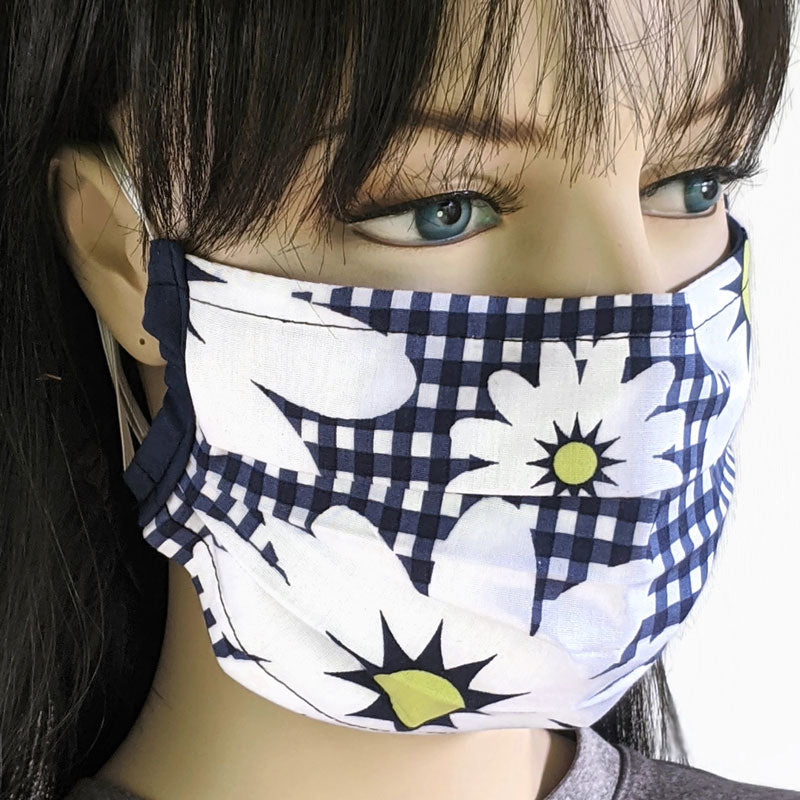 3 layer pleated folding style fabric face mask, featuring large daisies on navy gingham, one size