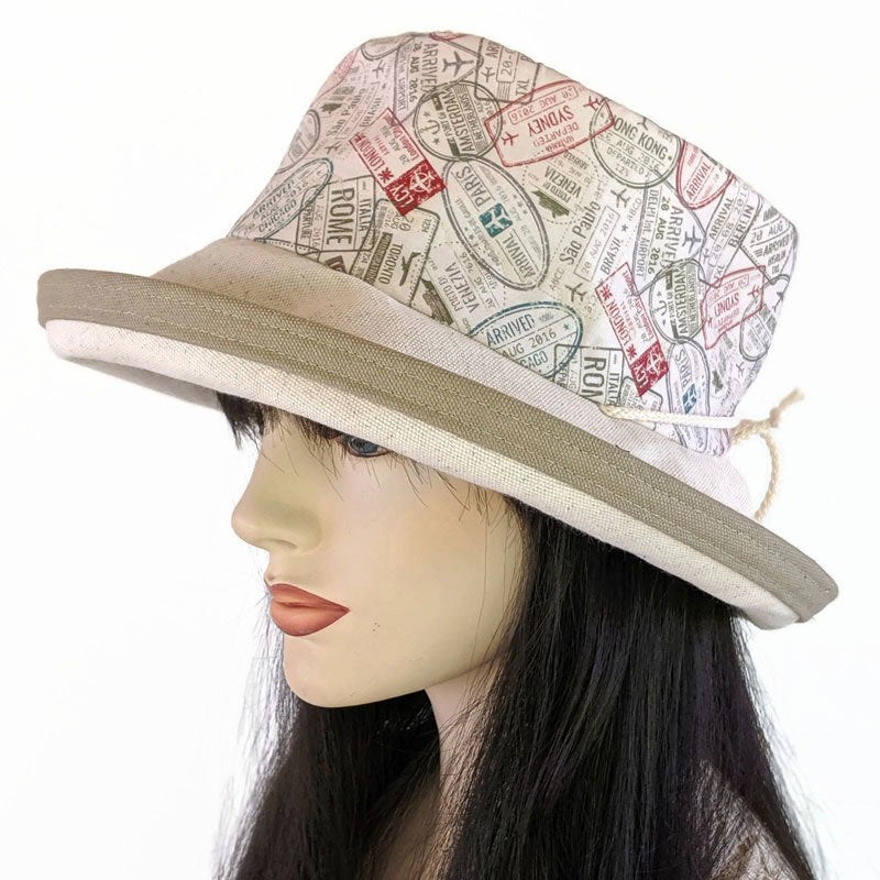 145 UV Sunblocker with wide brim featuring passport stamps