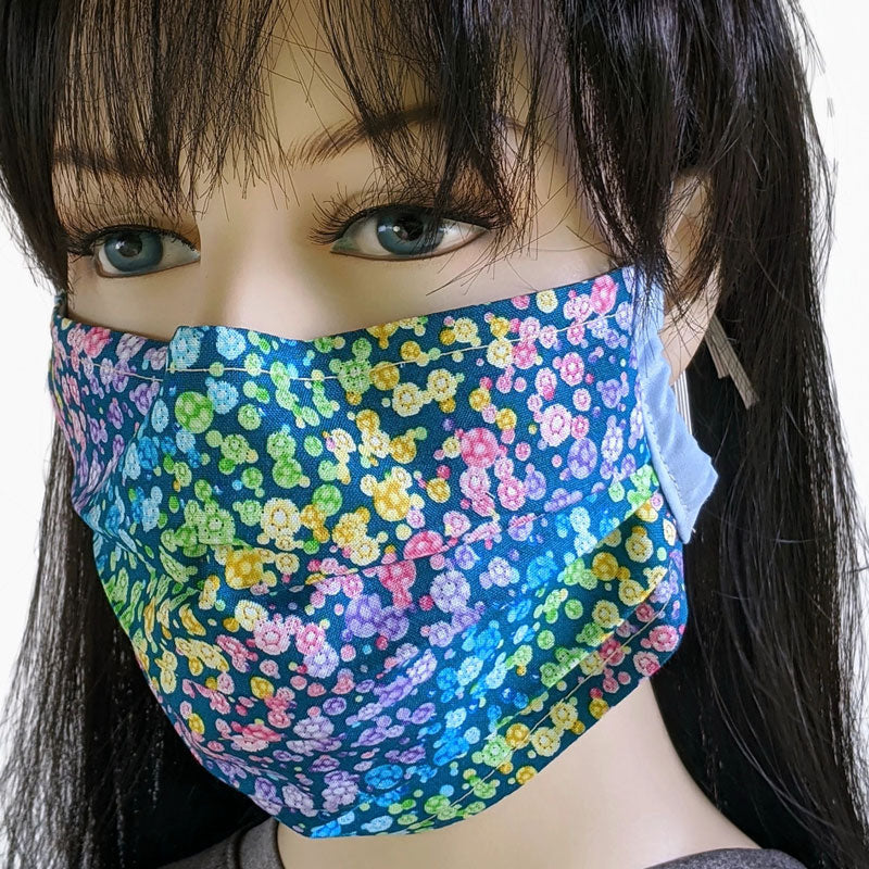 3 layer pleated folding style fabric face mask, featuring pastel rainbow in flowers, one size