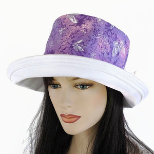 143 UV Sunblocker with large wide brim featuring pink, purple white butterflies