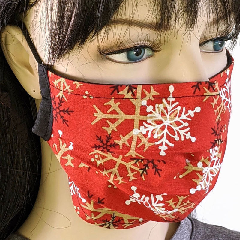 3 layer pleated folding style fabric face mask, snowflakes in black. white and gold on red, one size