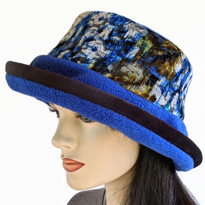 Premium Fashion Hat in royal with floral velvet trim, wide brim and earflap