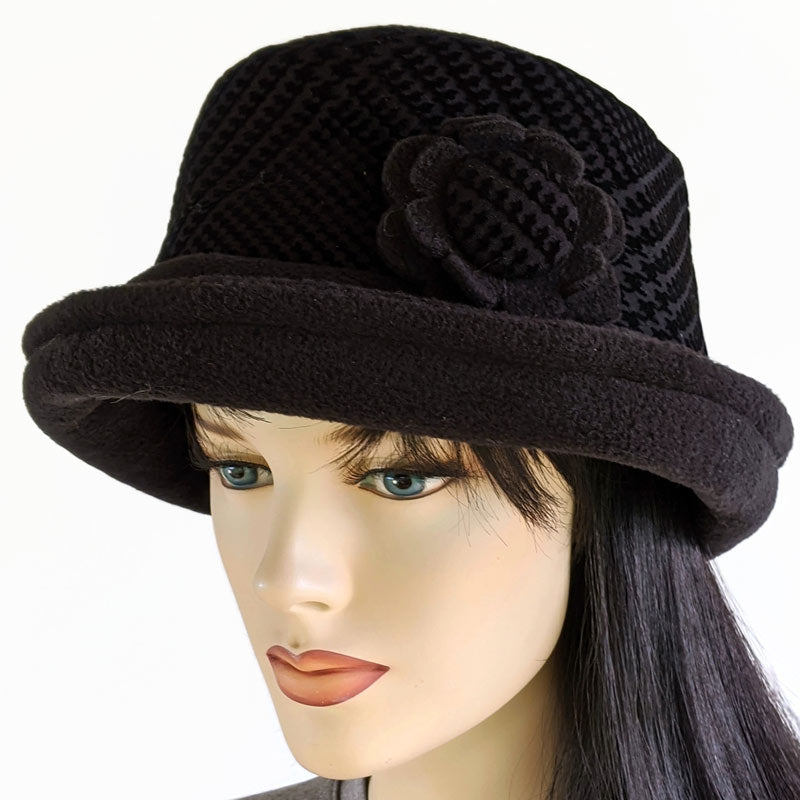 Fashion Hat in black with floral pin and soft edge brim with tuck up earflaps