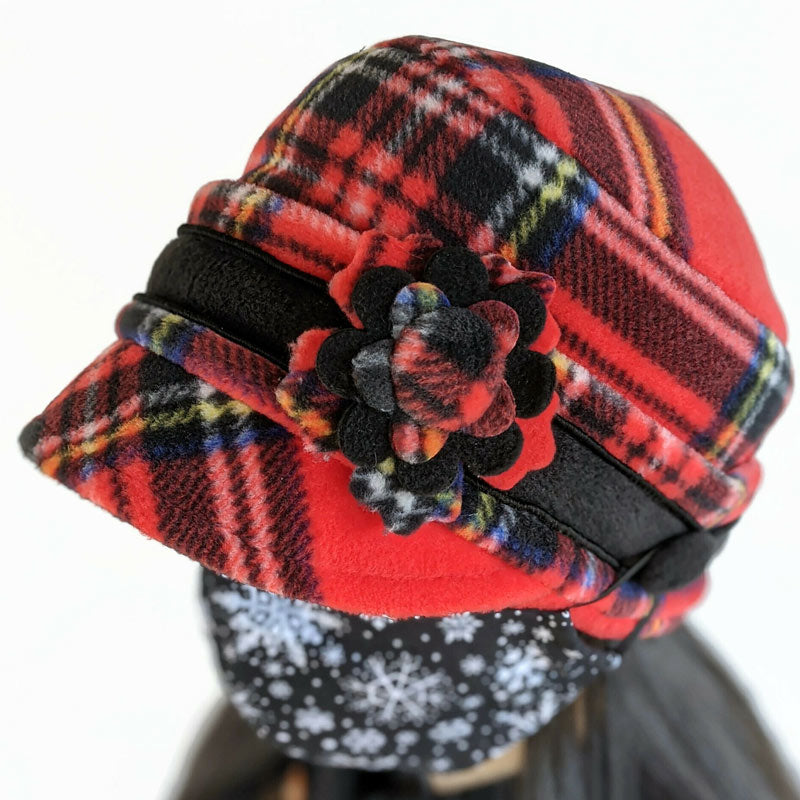 Fleece Cap with floral pin in Stewart plaid with ear saver buttons