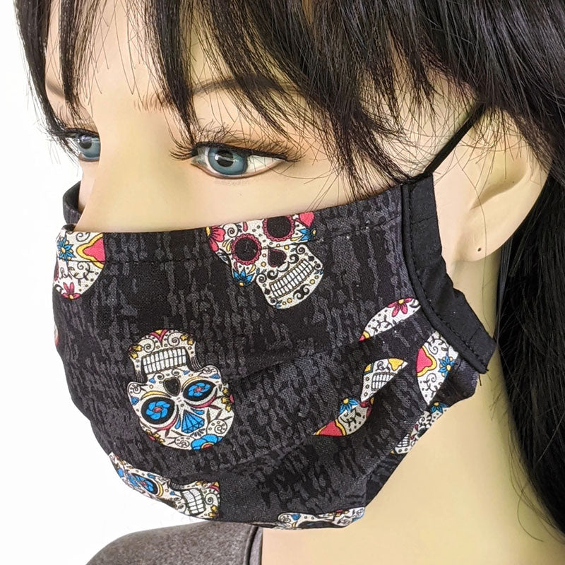 3 layer pleated folding style fabric face mask, featuring sugar skulls, one size