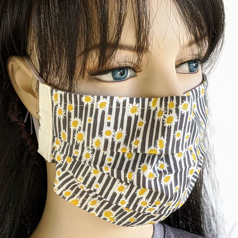 3 layer pleated folding style fabric face mask, featuring sunflowers, one size
